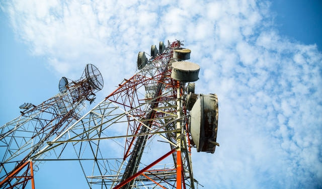 Fiberglass is transparent to radio waves, making it the preferred material for screening cellular towers.