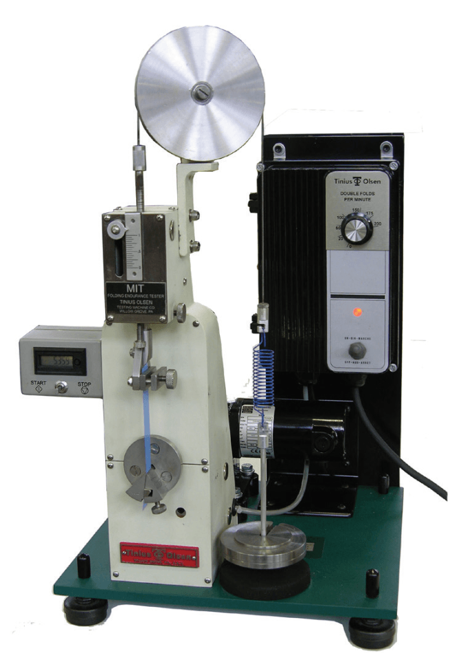 Model 2 Folding Endurance Tester with modified loading system, digital counter and variable speed drive for use on materials with relatively high amounts of elongation