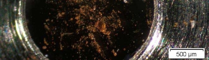 Optical Micrograph of Brown Residue on a sampling cell.