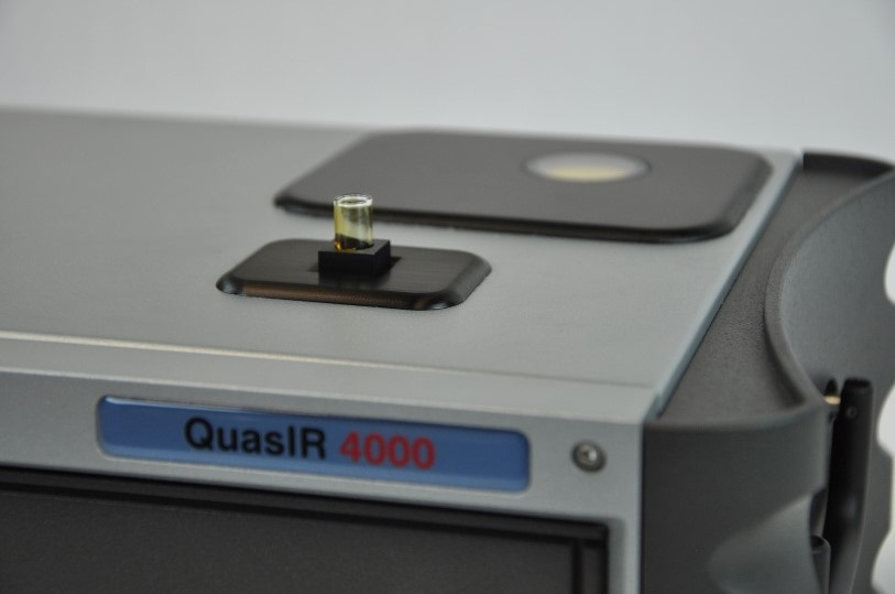 Sugarcane juice in glass vial analyzed with QuasIR™ 4000 sample compartment.