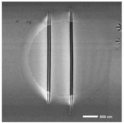 Suspended nano-ribbons created by helium ion milling. Left: 20 nm wide. Right: 10 nm wide.