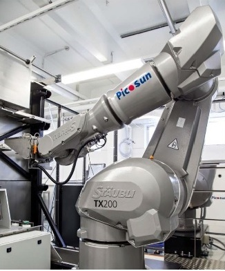 A PICOSUN™ P-300B production ALD system with industrial robot sample handling and loading.