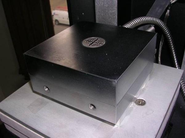 Reusable dielectric/conductivity sensor embedded in press platen