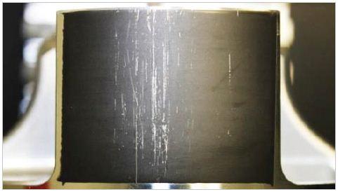 Overview image of engine piston skirt damage