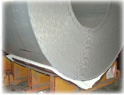 Aluminum coil on a V-rack with Mid-Mountain Materials ARMATEX QF40 Clear tray pad