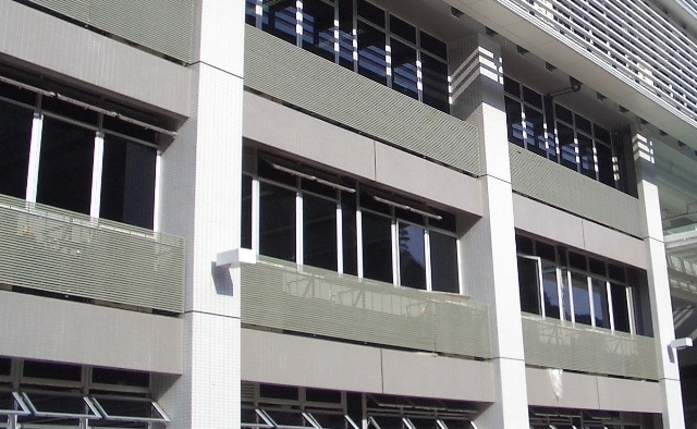 Strongwell DURADEK® I-6000 grating was installed at this School of Business and Information Systems in Hong Kong as air-conditioning platforms when placed horizontally and as louver when placed vertically (as shown here).
