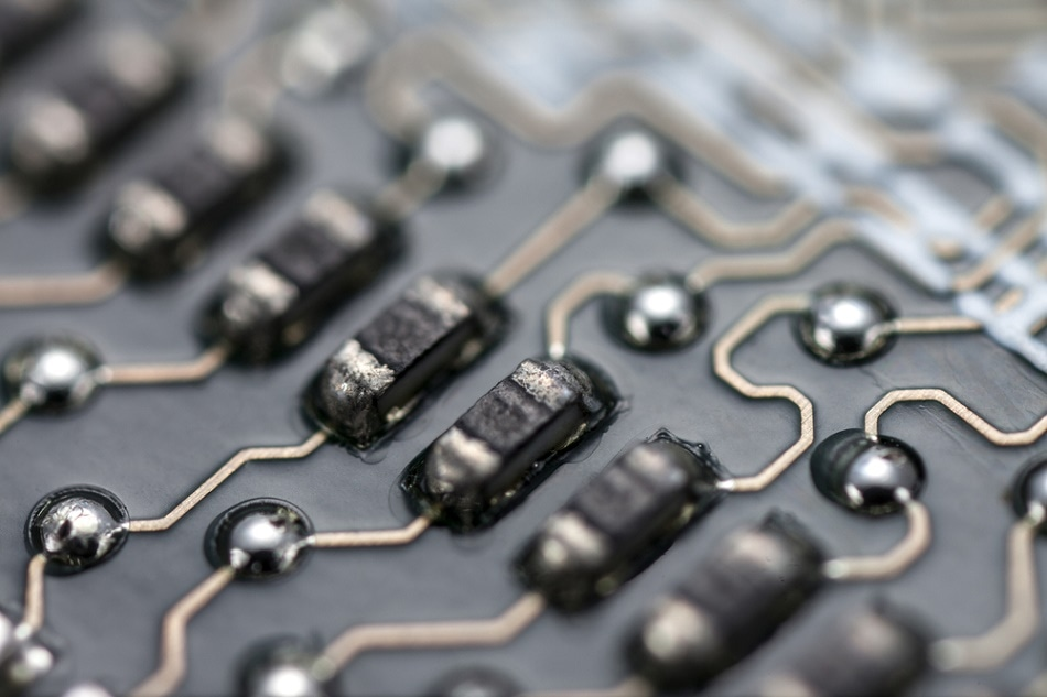Capacitors on a motherboard. Tantalum capacitors facilitate a very high capacitance per unit volume and short conduction paths.