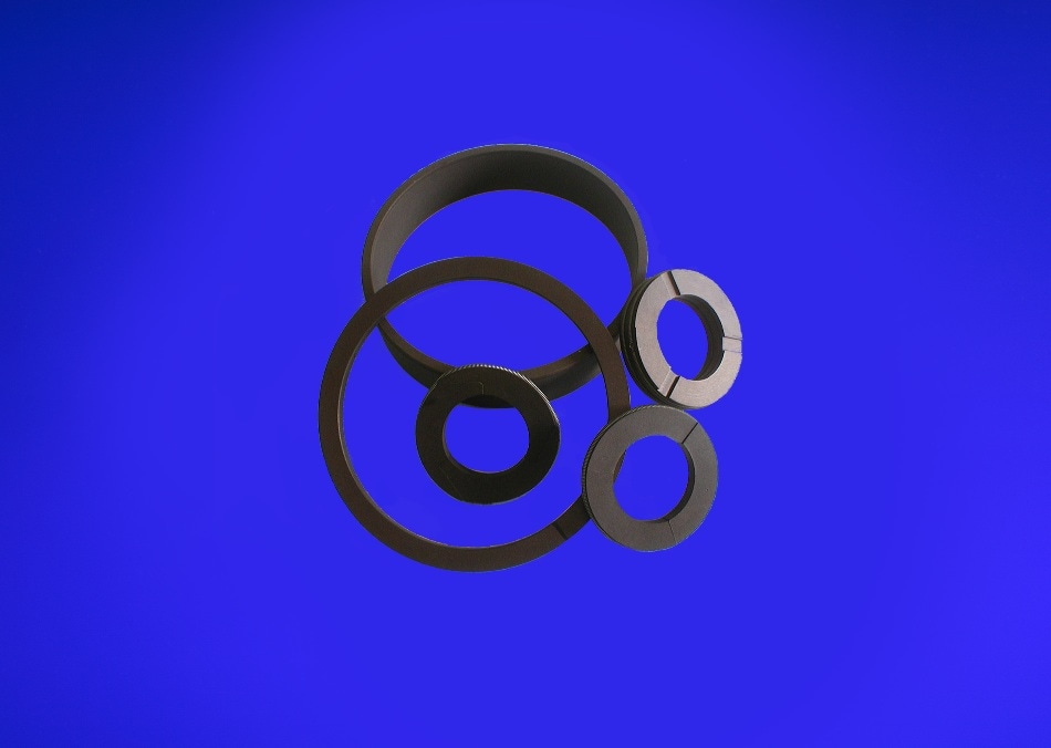 A bronzed filled PTFE is more suitable for air compressors where gas exceeds 20 bar