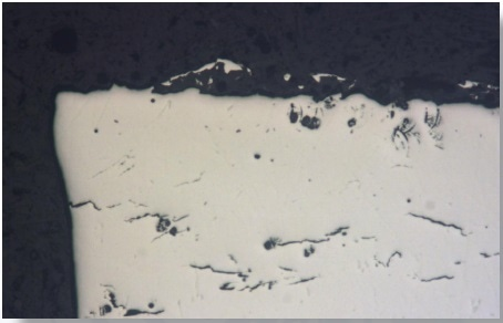 Image of the prepared specimen surface. Due to the polished surface the light is reflected almost equally and the microstructure is not discernible.