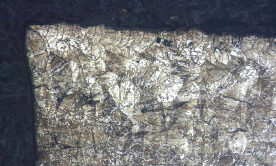 "Etched specimen using ""V2A Beize"" (for 45 s). Edge section. The microstructure is clearly discernible."