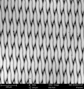 SEM images of two metal grids, using 15 kV (top) and 10 kV (bottom) beam