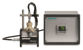 The Autolab RHD Microcell HC setup, composed of a cell stand (left-hand side), and the temperature controller (right-hand side).