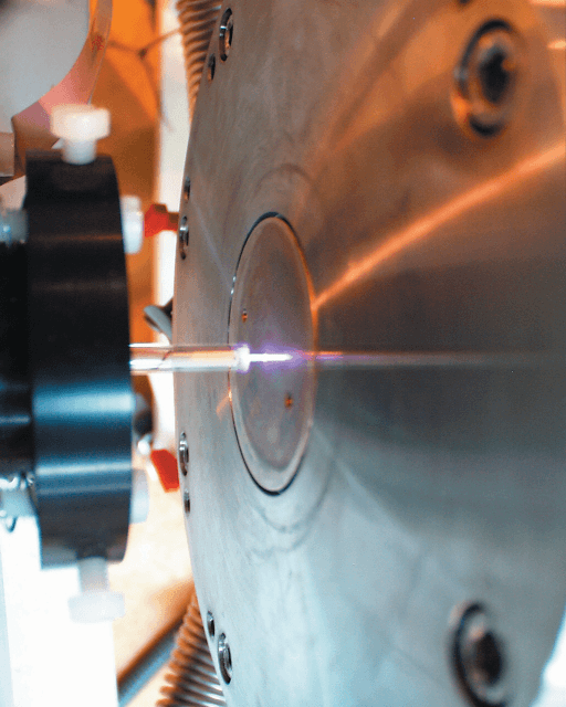 Atmospheric plasma produced between the RF electrode, or needle, and the sampling orifice of the Hiden Molecular Beam Mass Spectrometer.