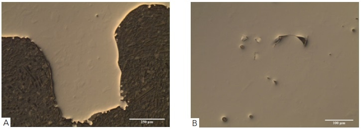 Showing (A) as polished surface of an additive manufactured Co-Cr acetabular cup viewed using differential interference contrast (DIC) through 10x objective, (B) showing porosity within the bulk alloy viewed using DIC through a 20X objective.