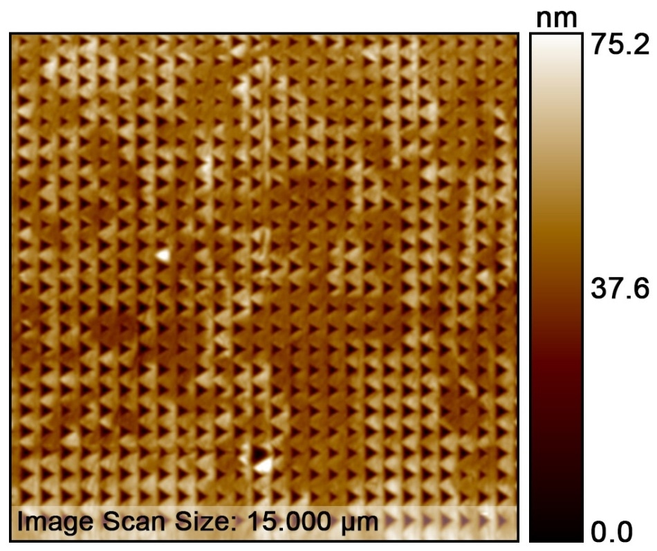 Topography image of the 100x100 indent pattern. The SPM image is showing a 15x15 µm scan of the 60x60 µm pattern area.