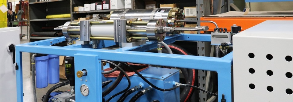 Robotic Cells with Hydraulic Intensifier Pumps