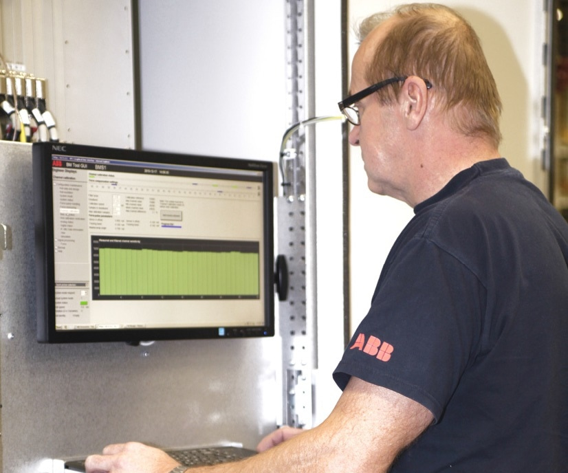 ABB Expert performing a comprehensive health check on a Stressometer system to enhance metal rolling mill performance and yield.