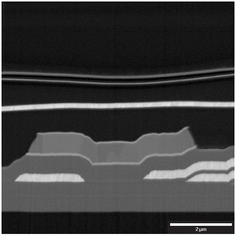 Detailed image of the Al contacts and SiO2/SiNx layer structure. Mid-Angle BSE detector at 2?kV.