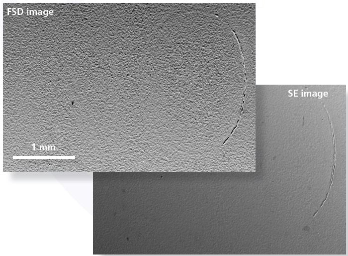 "Forescatter Diode (FSD, upper) and Secondary Electron (SE, lower) images show that only a partially visible letter ""O"" in the serial number is seen using traditional SEM techniques."