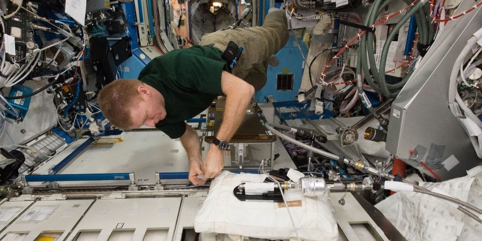 ESA astronaut Tim Peake working on the water processor assembly on board the ISS in 2016. Photo: NASA / flickr.com/photos/nasa2explore