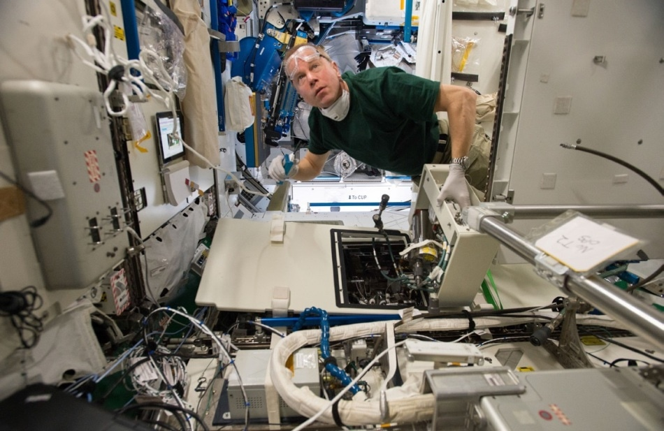 Astronaut Tim Kopra carrying out routine maintenance on the urine processor assembly. Photo: flickr.com/photos/ nasa2explore.