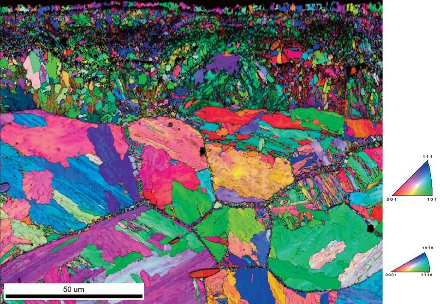 The EBSD Image Quality and IPF Orientation Map (relative to the surface normal direction) shows that the veins of Fe-N phases are extending through the boundaries between prior austenite grain boundaries.