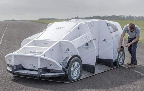 The Guided Soft Target (GST) consists of a foam-coreframe (top) covered by a vinyl skin (the Soft Car 360); anautonomous robotic platform (bottom) carries the mockup throughtest protocols at highway speeds and accelerations. (Courtesyof AB Dynamics)