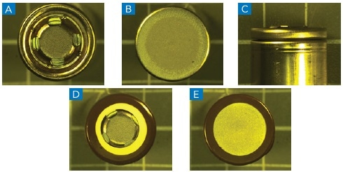 Illustrates the outer case structure of a cylindrical solid body lithium ion battery without the polymeric sheath with (a) showing the cathode, (b) anode side and (c) is a side view of the battery lid cap region, (d) and (e) illustrate the polymeric outer sheath.