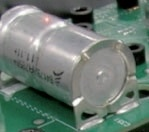 "Laser ""Dot"" indicating signal capture spot on the body of the Capacitor mounted on a PCB."