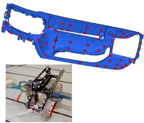 Simulation model and the trim part of the floor console held in a jig for vibrometer testing.