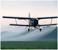 An agricultural sesquiplane in operation