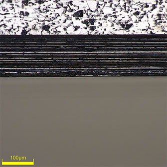 High-magnification (500x) image of the edge of a piston ring groove. You can clearly see that the edge is straight.