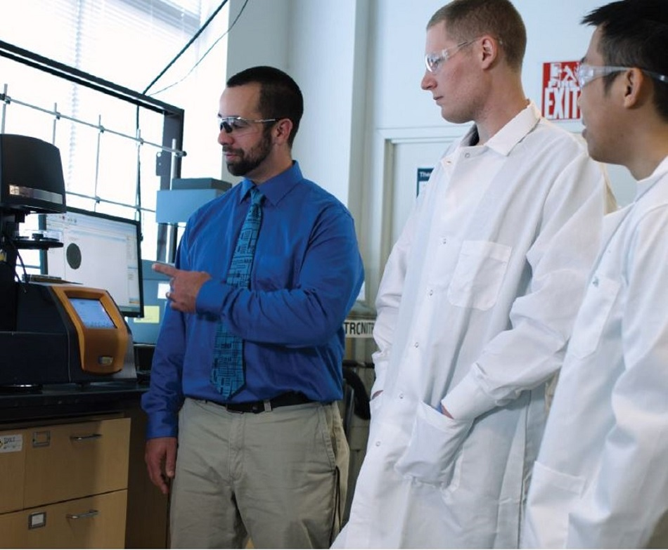 Dr. Stanzione in the Sustainable Materials Research Laboratory, Rowan University, with SMRL Ph.D. students Tristan Bacha (middle) and John Chea (right).