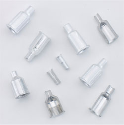 Hypodermic needle aluminum hubs and inserts.