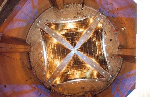 Deployed 20- meter solar sail on vacuum chamber floor.