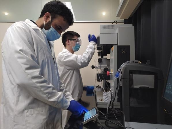 Adil and Yang, members of Prof. Wang's group at OSU, working with the Linkam temperature control setup in the lab.