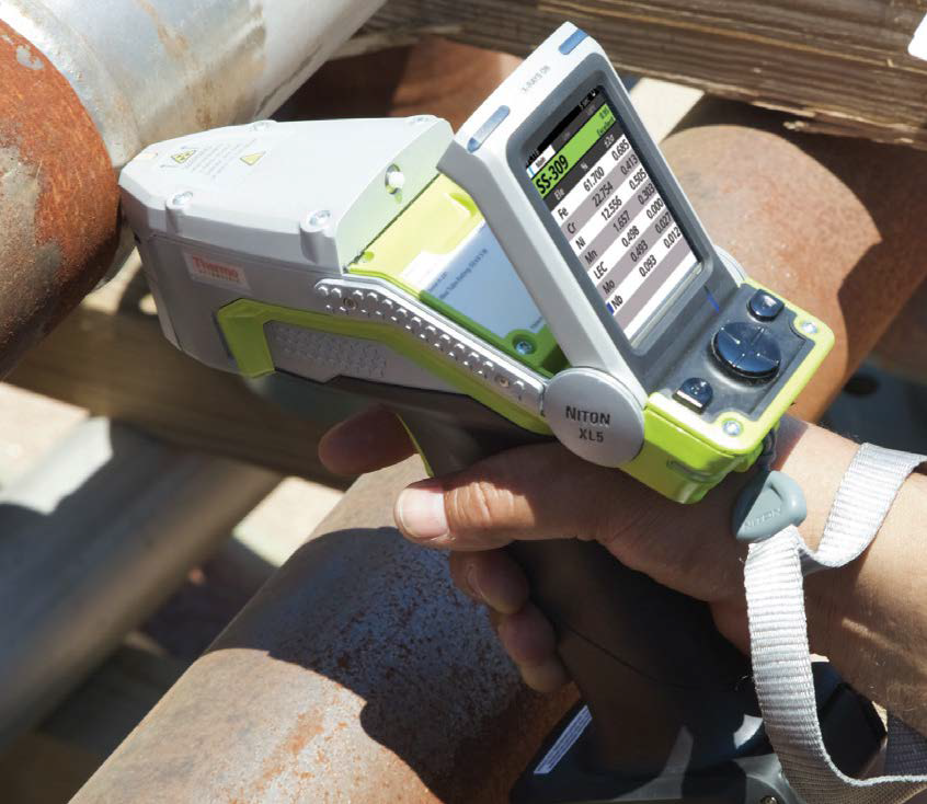 The Niton XL5 Plus in use, analyzing steel piping.