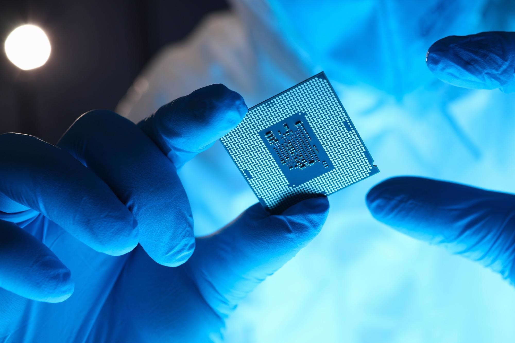 Hands in gloves hold chip testing microelectronics. Setting operating modes electronic controllers. Use chip tuning to increase power. Repair microprocessor electronics electrical equipment.