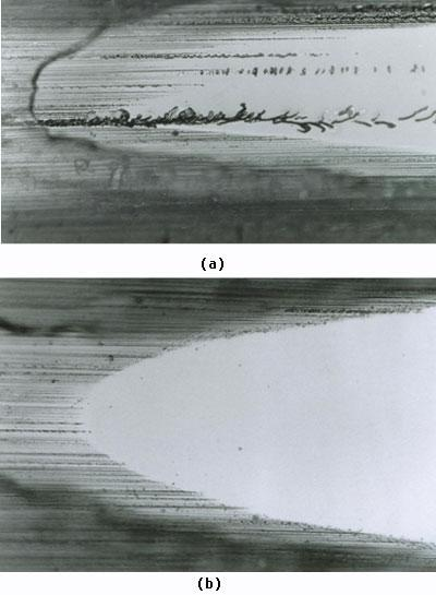 AZoJomo - The AZO Journal of Materials Online - Taper section showing ground edge of silicon wafer a) localised microcracking  b) damage free grinding.