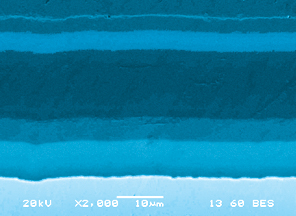InnerArmor films can use multiple layers to achieve finely-tuned performance characteristics. This SEM photo shows a four-layer film.