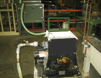 The Screen Box above shows water entry and water escape with shut-off valve. Pictured in the background is the Drying Oven (green).