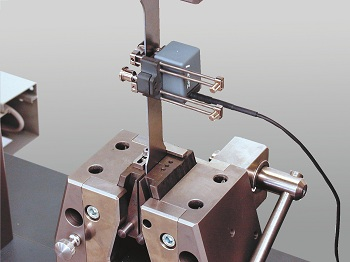A Zwick Roell Clip-on Extensometer - Measuring Strain on a Metal Specimen.