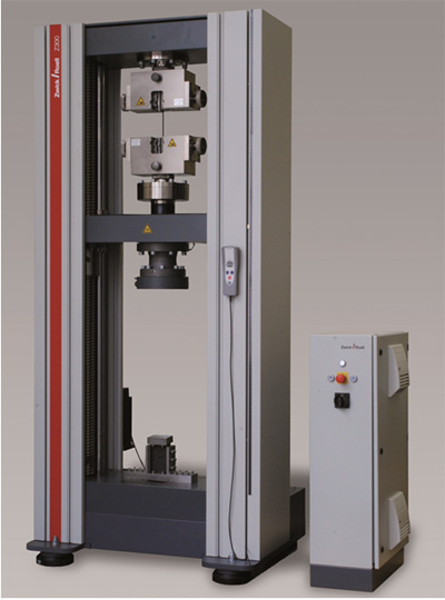 A materials testing machine with two test areas can be used for various tests on reinforced plastic composites without equipment change.