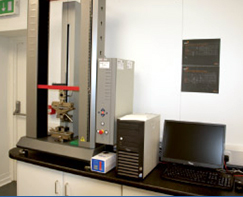 IPC's Zwick ProLine Z005 TN for tensile property testing of injection molded and punched dumbbell samples.