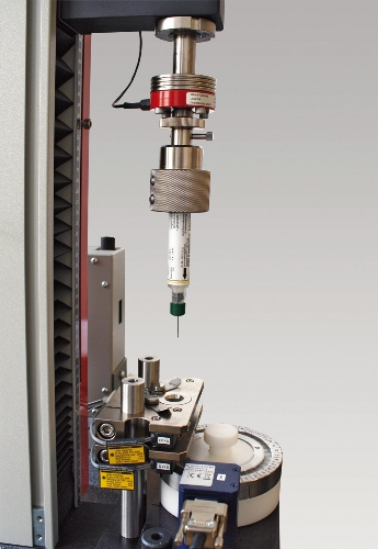 A zwicki-Line system engaged in characterization of an injection device. Specialized fixturing holds the specimen in position for a variety of different tests in accordance with customer requirements.