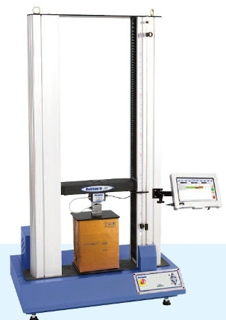 Crush test on cardboard packaging using a Multi Test 10i top-load tester.