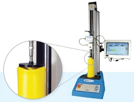 Top-load test on a PET bottle using a Multi-Test 2.5 xt top-load tester.