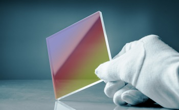 Understanding Photo-Structural Changes in Laser Processed Glass
