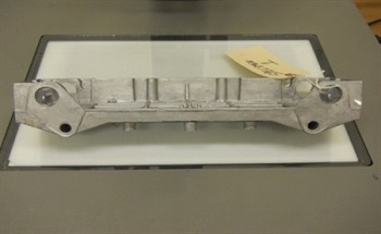 Failure Analysis of Contaminant Related Nonbonding of a Powder Coat to a Surface