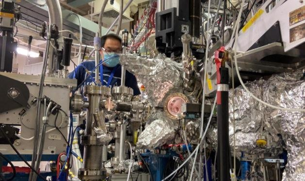 Wanli Yang, a senior scientist at Berkeley Lab's Advanced Light Source, working on a resonant inelastic X-ray scattering (RIXS) system. Yang adapted the RIXS technique for a recent Joule study on lithium-rich battery materials.